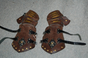 worn out leather gauntlets